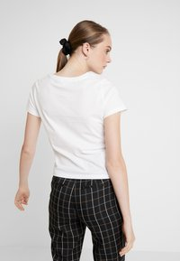 ONLY - ONLDISNEY FIT XMAS TOP BOX CO  - T-shirt con stampa - bright white/love - 2