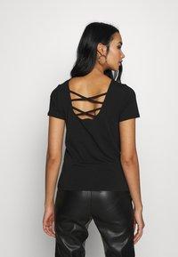 ONLY - ONLMATHILDE ORGANIC - T-shirt imprimé - black - 0