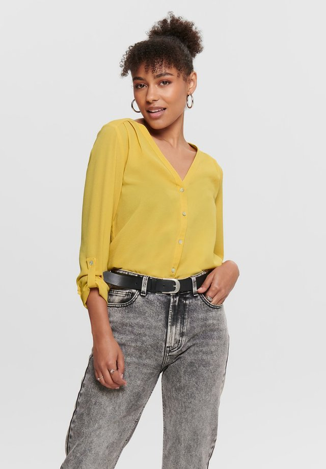 Blusa - misted yellow