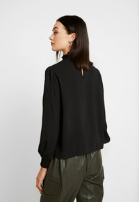 ONLY - ONLRUBIA SMOCK - Blouse - black - 2