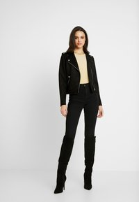 ONLY - ONLMAYO BIKER JACKET - Veste en similicuir - black - 1