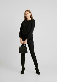 ONLY - ONLPUTTE O-NECK - Sweater - black - 1