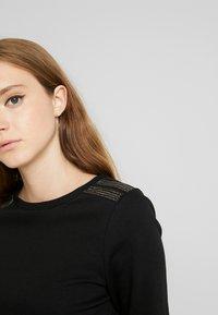 ONLY - ONLPUTTE O-NECK - Sweater - black - 4