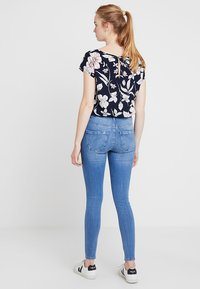 ONLY - ONLPAOLA HIGHWAIST - Jeans Skinny Fit - light blue denim