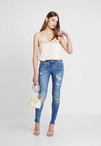 ONLY - ONLCARMEN REG  - Jeans Skinny Fit - light blue denim - 1