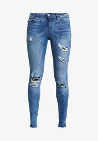 ONLY - ONLCARMEN REG  - Jeans Skinny Fit - light blue denim - 4
