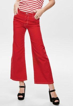 SONNY - Jeans a zampa - red
