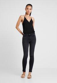 ONLY - ONYANNE MID ANKLE - Jeans Skinny Fit - black denim - 1