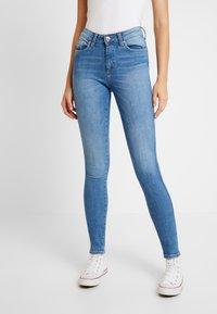 ONLY - ONLHUSH MID - Jeansy Skinny Fit - light blue denim - 0
