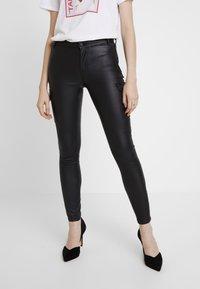 ONLY - ONLROYAL COATED PANT - Skinny džíny - black - 0