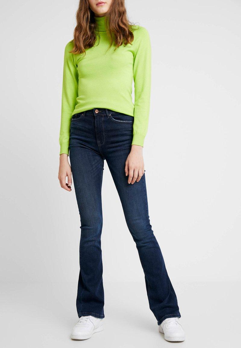ONLY - ONLPAOLA - Flared jeans - dark blue denim
