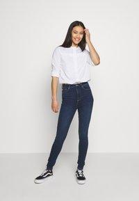ONLY - ONYGOSH HIGHWAIST  - Jeans Skinny Fit - dark blue denim - 1