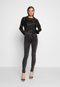ONLY - ONLRAIN ACID - Jeans Skinny Fit - black denim - 4
