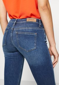 ONLY - ONLCORAL SWEET - Flared Jeans - medium blue denim - 4