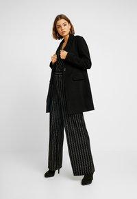 ONLY - ONLJODIE SHINE - Jumpsuit - black/silver - 1