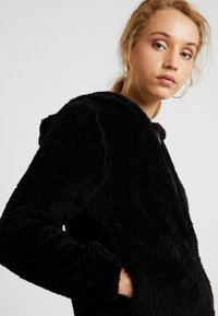 ONLY - ONLANNA CONTACT SHERPA - Winterjas - black