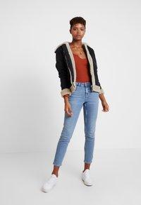 ONLY - ONLJUSTINE - Winter jacket - black - 1