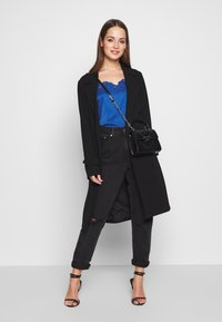 ONLY - ONLUNNA DRAPY COAT - Trenchcoat - black - 1