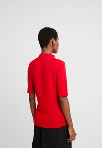 one more story - Print T-shirt - salsa red - 2