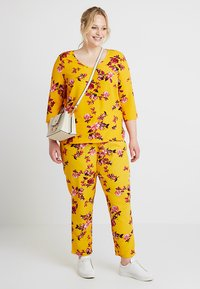 ONLY Carmakoma - CARLUX  PANTS - Trousers - yellow - 1