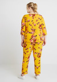 ONLY Carmakoma - CARLUX  PANTS - Trousers - yellow - 2