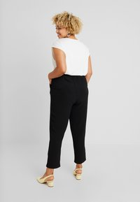 ONLY Carmakoma - Trousers - black - 3