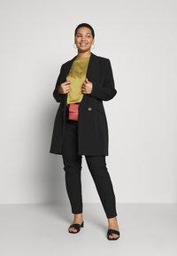 ONLY Carmakoma - CARRIDE PANTS - Spodnie materiałowe - black - 1