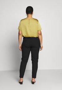 ONLY Carmakoma - CARRIDE PANTS - Spodnie materiałowe - black - 2