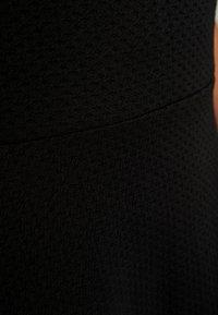 ONLY Carmakoma - CARFAVORITE KNEE DRESS - Jersey dress - black - 6