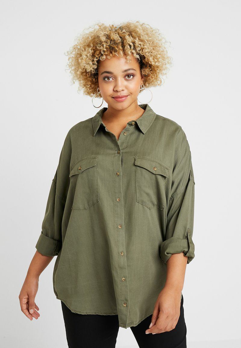 ONLY Carmakoma - CARGUNNVA OVERSIZE - Button-down blouse - grape leaf