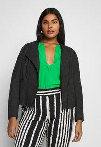 ONLY Carmakoma - CARAVANA BIKER - Faux leather jacket - black - 0