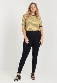 ONLY Carmakoma - CARSTORM - Jeans Skinny Fit - dark blue denim - 1