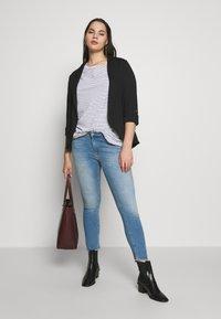 ONLY Carmakoma - CARWILLY - Jeans Skinny Fit - light blue denim - 1