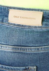 ONLY Carmakoma - CARTARA LIFE REGULAR  CROPED - Slim fit jeans - medium blue denim - 4