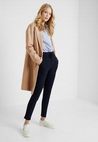 ONLY Tall - ONLLILLI PANTS - Spodnie materiałowe - dark blue - 1