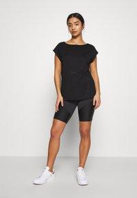 ONLY PLAY Petite - ONPMAGDALENA BURNOUT TEE PETITE - Print T-shirt - black - 1
