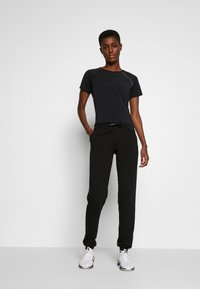 ONLY PLAY Tall - ONPPERFORMANCE PANTS - Tracksuit bottoms - black - 1