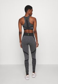 ONLY PLAY Tall - ONPMASHA LIFE CIRCULAR TIGHTS - Leggings - Trousers - black melange/black - 2