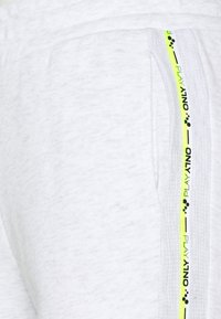 ONLY PLAY Tall - ONPALYSSA PANTS  - Tracksuit bottoms - white melange/safety yellow - 2