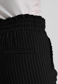 ONLY Petite - ONLPOPTRASH CLASSI PINSTRIPE FRILL - Trousers - black - 3