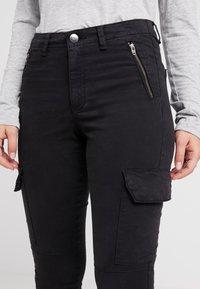 ONLY Petite - ONLPURPOSE REG ANKLE - Pantalon classique - black - 5