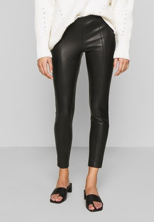 ONLTIA SUPERSTAR - Leggings - black