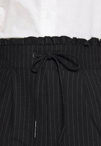 ONLY Petite - ONLPOPTRASH CLASSI PINSTRIPE FRILL - Pantalones - black - 5