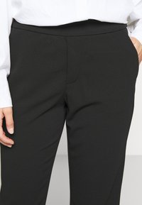 ONLY Petite - ONLADELE ROCKY PANTS  - Bukse - black - 4