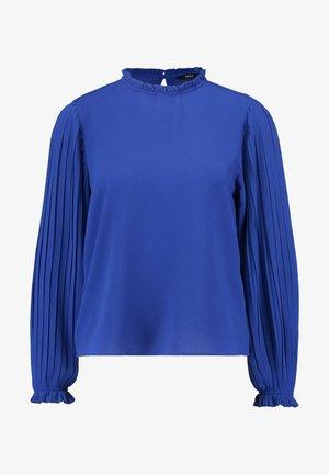 ONLFAITH FRILL TOP - T-shirt à manches longues - surf the web
