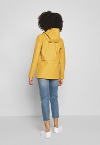 ONLY Petite - ONLTRAIN SHORT RAINCOAT - Parka - yolk yellow - 2