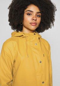 ONLY Petite - ONLTRAIN SHORT RAINCOAT - Parka - yolk yellow - 4
