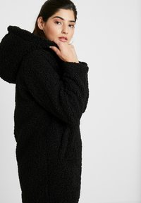 ONLY Petite - ONLTERRY CURLY FUR HOOD COAT - Winter coat - black