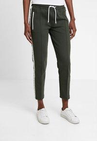 Marc O'Polo DENIM - TRACK PANTS - Tracksuit bottoms - action green - 0