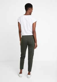 Marc O'Polo DENIM - TRACK PANTS - Tracksuit bottoms - action green - 2